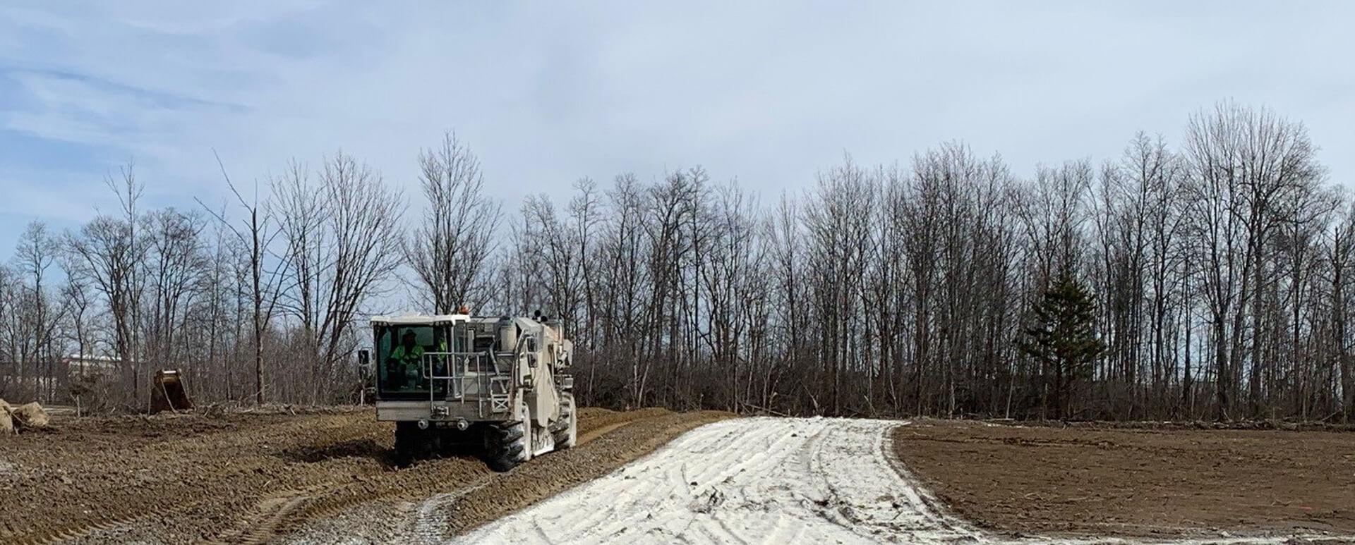 Machine laying lime on soil